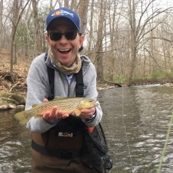 Image of a Client Fly Fishing the tulpehocken creek for trout with Top Water Trips